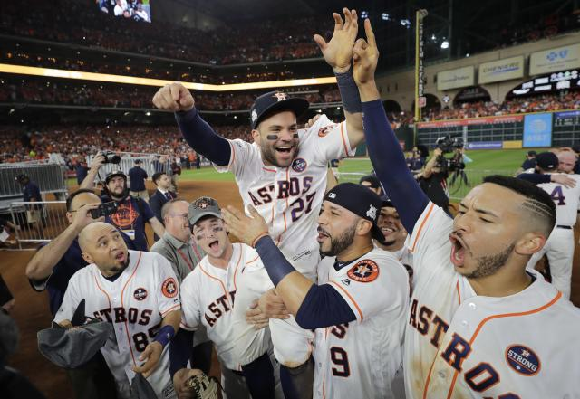 Houston Astros' Jose Altuve is lifted by teammates after Game 7 of baseball's American League Championship Series against the New York Yankees Saturday, Oct. 21, 2017, in Houston. The Astros won 4-0 to win the series. (AP)