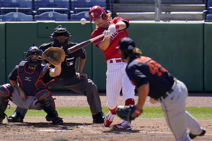 Philadelphia Phillies' Luke Williams hits a three-run home run off Detroit Tigers pitcher Buck Farmer (45) during the fourth inning of a spring training exhibition baseball game at BayCare Ballpark in Clearwater, Fla., Wednesday, March 10, 2021. Catching is Jake Rogers. (AP Photo/Gene J. Puskar)