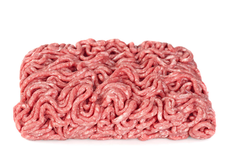 Raw minced (ground) meat isolated on a white