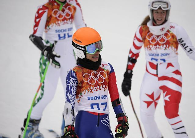 Violinst Vanessa Mae starting under her father's name as Vanessa Vanakorn for Thailand celebrates after competing in the first run of the women's giant slalom at the Sochi 2014 Winter Olympics, Tuesday, Feb. 18, 2014, in Krasnaya Polyana, Russia.(AP Photo/Gero Breloer)