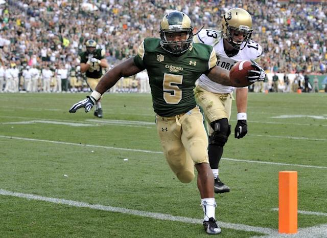 Colorado State running back Kapri Bibbs (5) scores a touchdown against Colorado defensive back Parker Orms (13) during the second quarter of an NCAA college football game Sunday, Sept. 1, 2013, in Denver. (AP Photo/Jack Dempsey)