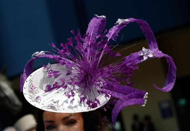 <p>A racegoer wears an ornate hat as she arrives for the first day of the Royal Ascot horse race meeting in Ascot, England, Tuesday, June 20, 2017. (AP Photo/Alastair Grant) </p>