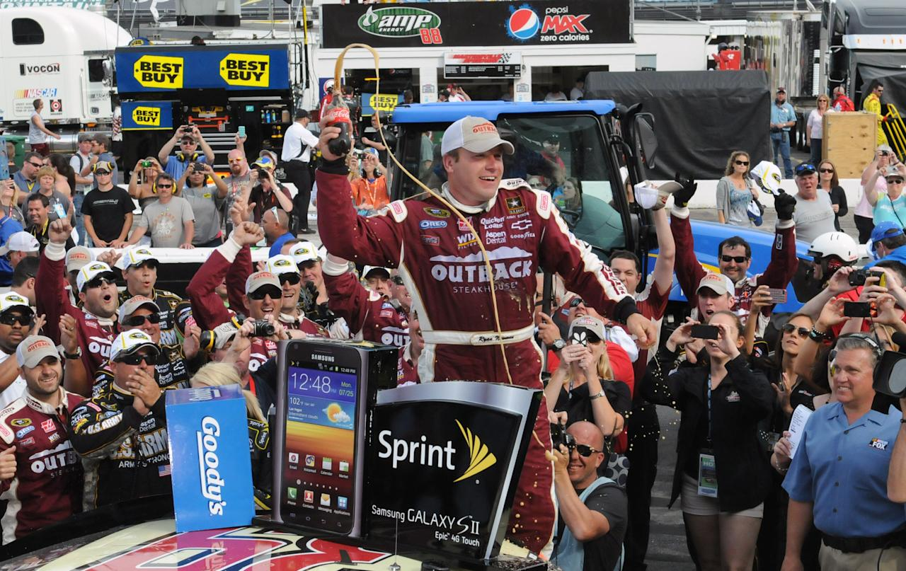 Ryan Newman celebrates in victory lane after winning the NASCAR Sprint Cup Series auto race Sunday, April 1, 2012, in Martinsville, Va. (AP Photo/Don Petersen)