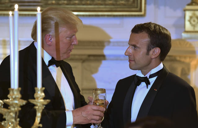 <p>President Donald Trump, left, and French President Emmanuel Macron, right, share a toast during the State Dinner at the White House in Washington, Tuesday, April 24, 2018. (Photo: Susan Walsh/AP) </p>