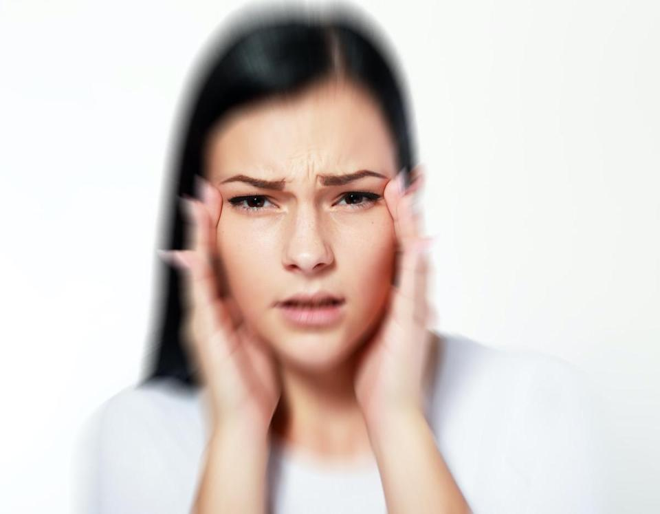 woman over white with blurred vision and focus problems