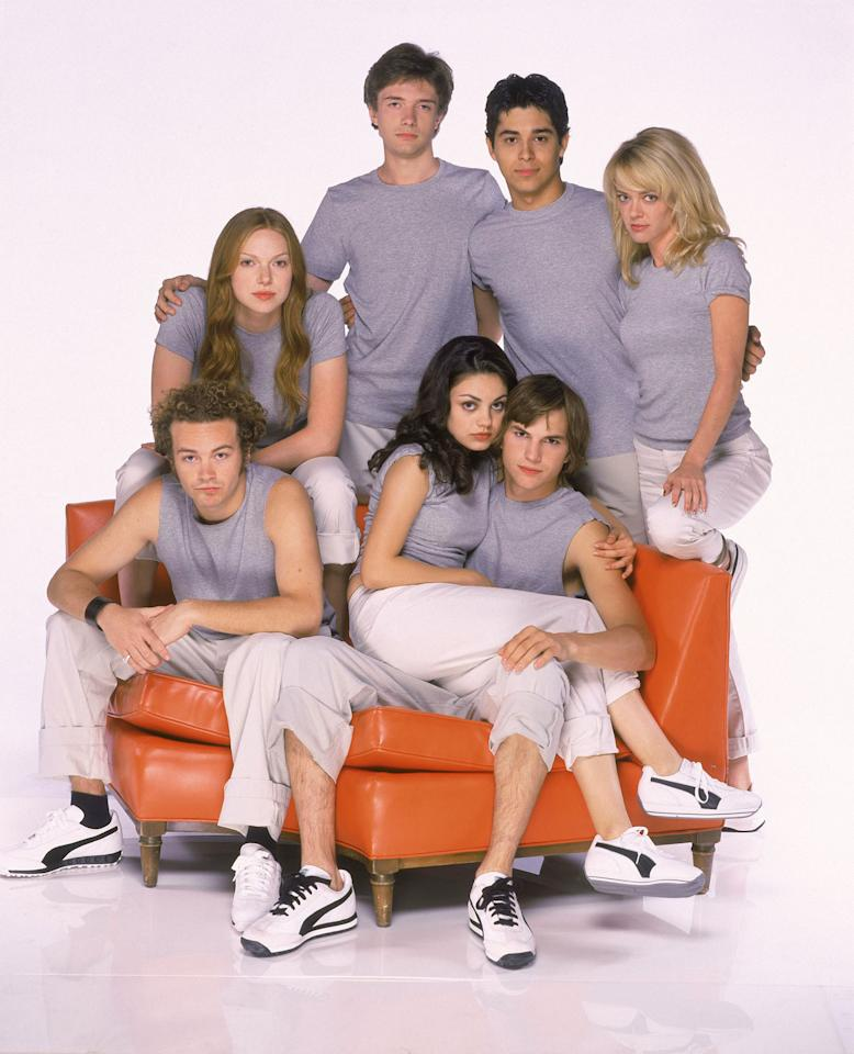 "Topher Grace, Wilmer Valderrama, Lisa Robin Kelly, Ashton Kutcher, Mila Kunis, Danny Masterson, and Laura Prepon in ""That '70s Show."""
