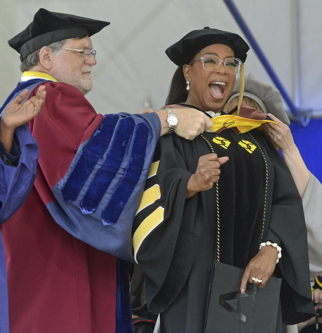 <p>Bill E. Peterson, Associate Provost and Dean of Academic Development, left, presents Oprah Winfrey with an honorary degree during Smith College's 139th Commencement ceremony on Sunday, May 21, 2017 in Northampton, Mass. The author, actress, philanthropist and former talk show host gave the college's commencement address. (Photo: David Molnar/Springfield Republican via AP) </p>