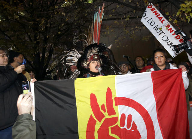 Several hundred American Indians and their supporters gather outside the Metrodome to protest the Washington Redskins' name, prior to an NFL football game between the Redskins and the Minnesota Vikings, Thursday, Nov. 7, 2013, in Minneapolis. (AP Photo/Jim Mone)