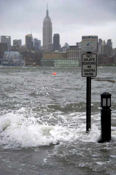 The Hudson River swells and rises over the banks of the Hoboken, N.J., waterfront as Hurricane Sandy approaches on Monday, Oct. 29, 2012. Hurricane Sandy continued on its path Monday, forcing the shutdown of mass transit, schools and financial markets, sending coastal residents fleeing, and threatening a dangerous mix of high winds and soaking rain.(AP Photo/Charles Sykes)