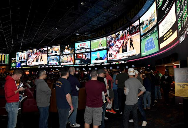 Normally, it's standing room only at sportsbooks in Las Vegas during March Madness. But with the coronavirus shutting down the NCAA tournament, betting revenue is down up to 99 percent. (Ethan Miller/Getty Images)