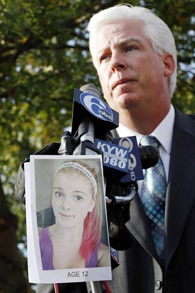 A photograph of Autumn Pasquale is seen as Gloucester County Prosecutor Sean Dalton addresses a gathering outside town hall Tuesday, Oct. 23, 2012, in Clayton, N.J., not far from where a body preliminarily identified as the missing 12-year-old girl's was found in a home's recycling bin. The Gloucester County Prosecutor's Office announced early Tuesday that they believed the body of Autumn Pasquale was found around 10 p.m. Monday, in a recycling bin at a home just blocks away from her house and from Borough Hall, where thousands of people gathered earlier in the evening for a tearful candlelight vigil to pray for the girl's safe return. (AP Photo/Mel Evans)