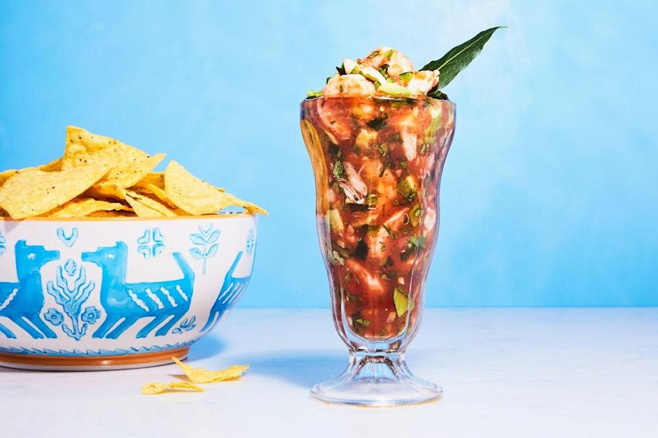 """This campechana recipe is the perfect marriage of plump shrimp, sweet crabmeat, juicy tomato, smoky New Mexican chiles, briny olives, and creamy avocado. This version was adapted from the ever-popular appetizer served at <a href=""""http://www.goodecompany.com/seafood.asp"""" rel=""""nofollow noopener"""" target=""""_blank"""" data-ylk=""""slk:Goode Company Seafood"""" class=""""link rapid-noclick-resp"""">Goode Company Seafood</a> in Houston, TX. <a href=""""https://www.epicurious.com/recipes/food/views/campechana-extra-mexican-seafood-cocktail?mbid=synd_yahoo_rss"""" rel=""""nofollow noopener"""" target=""""_blank"""" data-ylk=""""slk:See recipe."""" class=""""link rapid-noclick-resp"""">See recipe.</a>"""