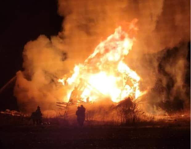 Firefighters responded to the fire at 200 Norwood Rd. before midnight Saturday. (Submitted by Sarah MacLeod - image credit)