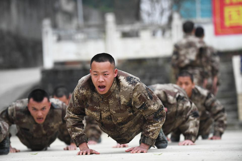 New recruits undergo physical training at a pre-service education base in southwest China.