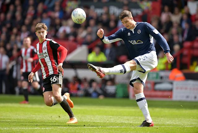"Soccer Football - Championship - Sheffield United vs Millwall - Bramall Lane, Sheffield, Britain - April 14, 2018 Millwall's Jake Cooper in action with Sheffield United's David Brooks Action Images/Paul Burrows EDITORIAL USE ONLY. No use with unauthorized audio, video, data, fixture lists, club/league logos or ""live"" services. Online in-match use limited to 75 images, no video emulation. No use in betting, games or single club/league/player publications. Please contact your account representative for further details."
