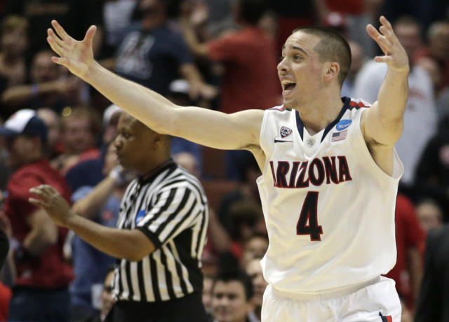 Arizona guard T.J. McConnell (4) celebrates against San Diego State during the second half in a regional semifinal NCAA college basketball tournament game, Thursday, March 27, 2014, in Anaheim, Calif. (AP Photo/Jae C. Hong)
