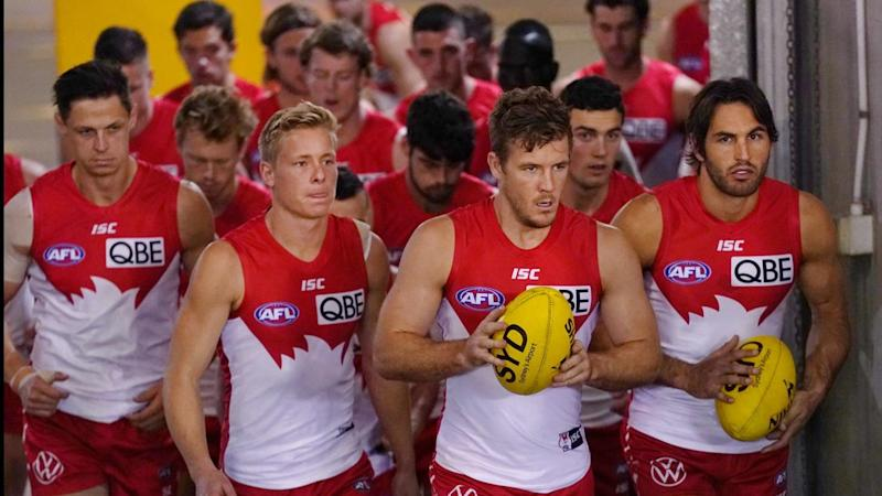 Luke Parker (centre, front row) says his Swans side need to match the Bulldogs' snarl in the AFL