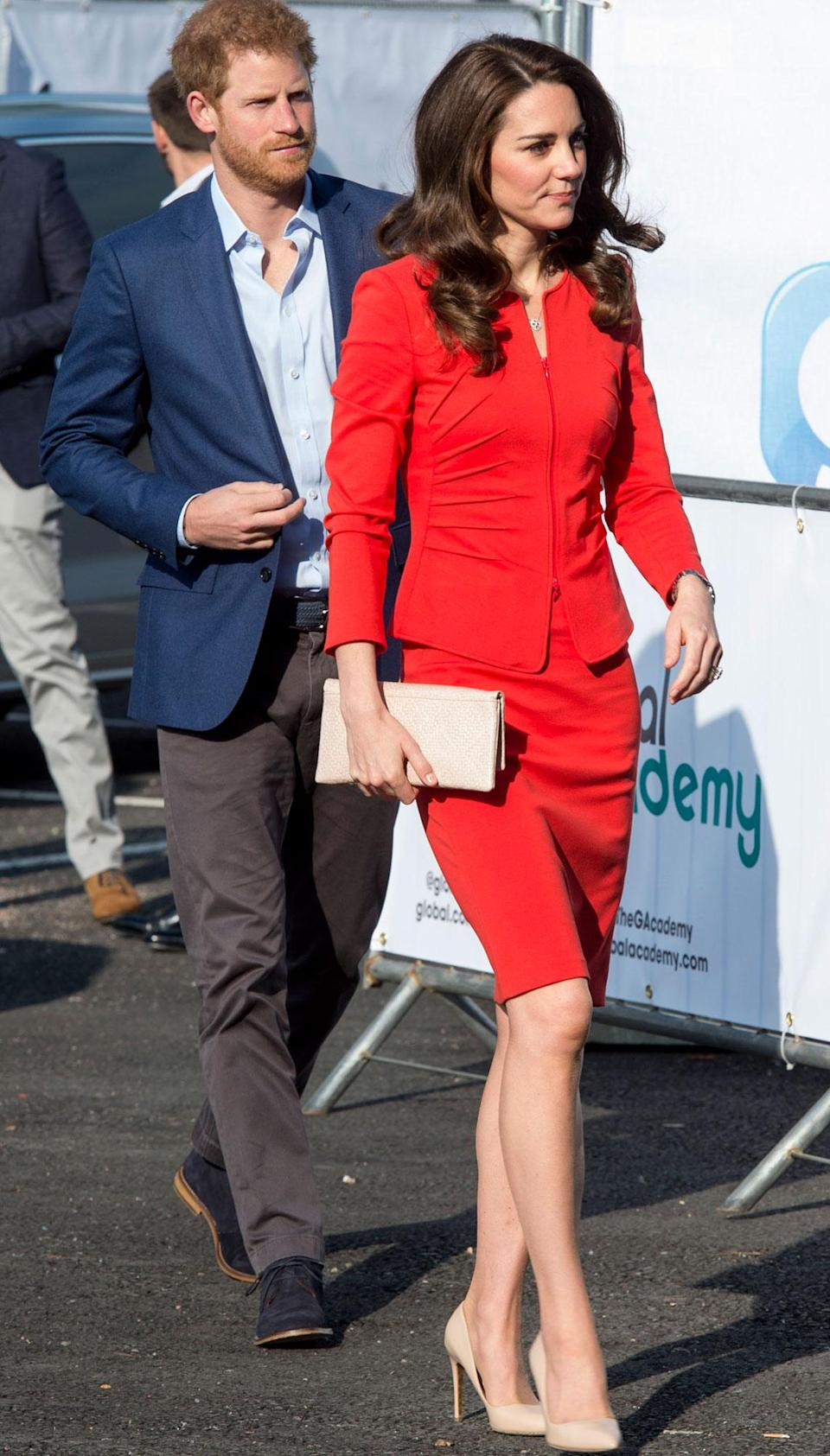 """<p><strong>When:</strong> April 20, 2017 <strong>Where:</strong> Meeting students at the Global Academy in Hayes, west London <strong>Wearing:</strong> Armani Collezioni fiery red suit <strong>Get the Look:</strong> DVF Long-Sleeve A-Line Wrap Dress, $239; <a href=""""http://www.gopjn.com/t/8-8896-131940-82634?sid=POROYALSKateSpringStyleMM&url=https%3A%2F%2Fwww.dvf.com%2Flong-sleeve-a-line-wrap-dress%2F10726DVF.html%3Fdwvar_10726DVF_size%3D12%26dwvar_10726DVF_color%3DBRIRE%26gdffi%3D3d633cebe7ee4ed1bb4fe56c4a52509b%26gdfms%3D28A58DACAC0043DEA3EE71064EAC00C8%26gclid%3DEAIaIQobChMImq3A6Nbl2QIVDpt-Ch2amwlgEAYYASABEgJsAfD_BwE%26gclsrc%3Daw.ds"""" rel=""""nofollow noopener"""" target=""""_blank"""" data-ylk=""""slk:dvf.com"""" class=""""link rapid-noclick-resp"""">dvf.com</a> Lauren Ralph Lauren Keyhole Jersey Dress, $87; <a href=""""https://click.linksynergy.com/fs-bin/click?id=93xLBvPhAeE&subid=0&offerid=465536.1&type=10&tmpid=2425&RD_PARM1=https%3A%2F%2Fwww.bloomingdales.com%2Fshop%2Fproduct%2Flauren-ralph-lauren-keyhole-jersey-dress%3FID%3D2795290%2526CategoryID%3D2910&u1=POROYALSKateSpringStyleMM"""" rel=""""nofollow noopener"""" target=""""_blank"""" data-ylk=""""slk:bloomingdales.com"""" class=""""link rapid-noclick-resp"""">bloomingdales.com</a> ASOS Long Sleeve Midi Pencil Dress, $60, <a href=""""https://click.linksynergy.com/fs-bin/click?id=93xLBvPhAeE&subid=0&offerid=460292.1&type=10&tmpid=20904&RD_PARM1=http%3A%2F%2Fus.asos.com%2Fasos%2Fasos-long-sleeve-midi-pencil-dress%2Fprd%2F8570245%3Fclr%3Dred%2526SearchQuery%3Dred%2520long%2520sleeve%2520pencil%2520dress%2526gridcolumn%3D1%2526gridrow%3D1%2526gridsize%3D4%2526pge%3D1%2526pgesize%3D72%2526totalstyles%3D26&u1=POROYALSKateSpringStyleMM"""" rel=""""nofollow noopener"""" target=""""_blank"""" data-ylk=""""slk:asos.com"""" class=""""link rapid-noclick-resp"""">asos.com</a> Kasper Crepe One-Button Jacket, $69.99, <a href=""""https://click.linksynergy.com/fs-bin/click?id=93xLBvPhAeE&subid=0&offerid=486467.1&type=10&tmpid=1513&RD_PARM1=https%3A%2F%2Fwww.macys.com%2Fshop%2Fproduct%2Fkasper-crepe-one-butt"""