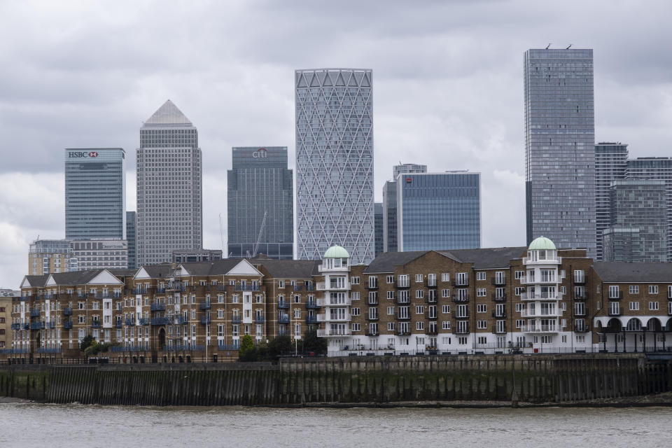 View looking across the River Thames over residential housing towards Canary Wharf and the Docklands financial district which has come to the end of one of its periods of growth as most of the cranes have disappeared on 27th August in London, United Kingdom. Two of the newest, and tallest towers have complete exteriors: Newfoundland on the left, and Landmark Pinnacle on the right. Canary Wharf is the secondary central business district of London and is situated on the Isle of Dogs. It is one of the main financial centres in the world, containing many of the tallest buildings, including the second-tallest in the UK, One Canada Square. (photo by Mike Kemp/In Pictures via Getty Images)