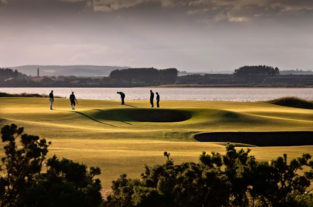 "<h1 class=""title"">Golfers-Silhouette-Scenic.jpg</h1> <div class=""caption""> Silhouette of people golfing on The Old Course golf grounds in St Andrews. Grey sky, shaded view of grounds. Hole 12. </div> <cite class=""credit"">Getty Images</cite>"