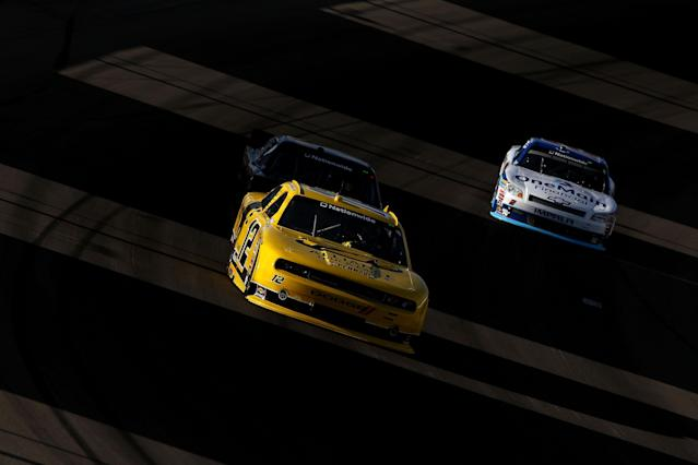 LAS VEGAS, NV - MARCH 10: Sam Hornish Jr., driver of the #12 Alliance Truck Parts Dodge, leads Brendan Gaughan, driver of the #33 South Point Hotel & Casino Chevrolet, and Elliott Sadler, driver of the #2 OneMain Financial Chevrolet, during the NASCAR Nationwide Series Sam's Town 300 at Las Vegas Motor Speedway on March 10, 2012 in Las Vegas, Nevada. (Photo by Ezra Shaw/Getty Images)