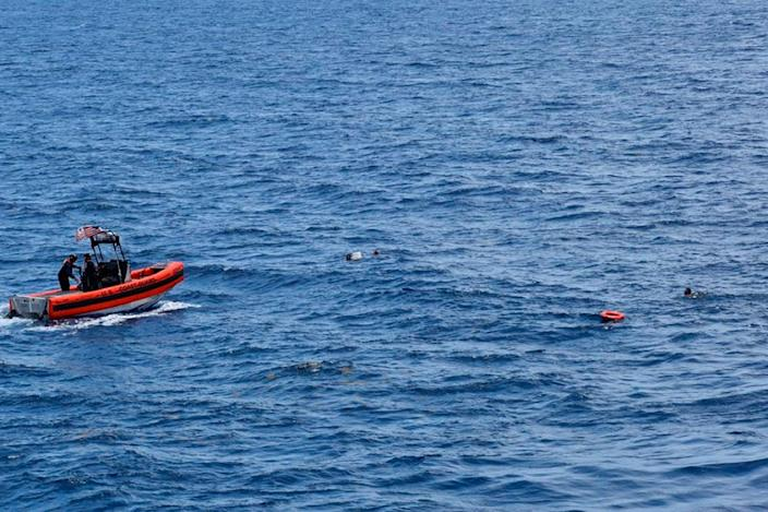 <p>A Coast Guard crew rescues eight people from the water approximately 16 miles south of Key West</p> (US Coast Guard)