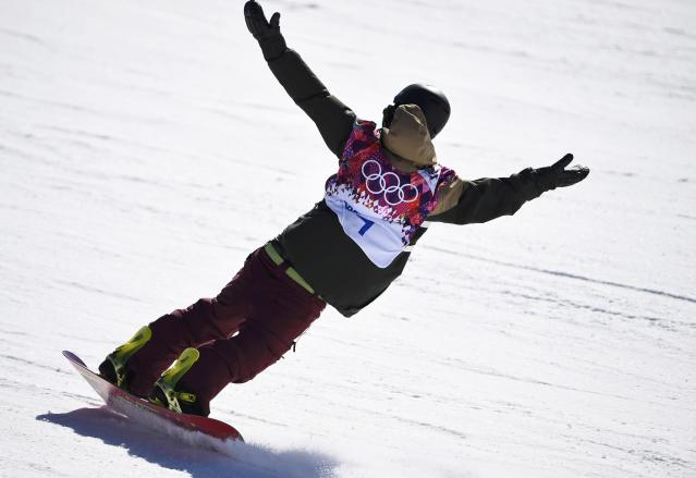 Japan's Yuki Kadono reacts on the finish line during the men's snowboard slopestyle final competition at the 2014 Sochi Olympic Games in Rosa Khutor during the men's slopestyle snowboarding competition at the 2014 Sochi Olympic Games in Rosa Khutor February 8, 2014. REUTERS/Dylan Martinez (RUSSIA - Tags: OLYMPICS SPORT SNOWBOARDING)