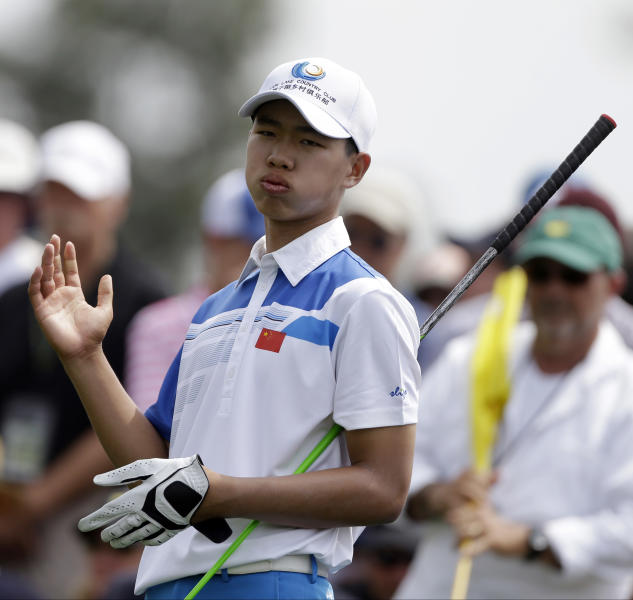 Amateur Guan Tianlang, of China, tees off on the eighth hole during the first round of the Masters golf tournament Thursday, April 11, 2013, in Augusta, Ga. (AP Photo/David Goldman)