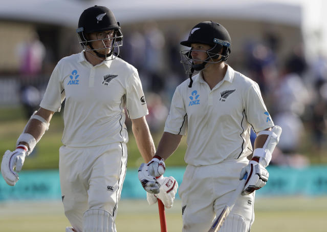 New Zealand not out batsmen BJ Watling, right, and Mitchell Santner walk from the filed at the close of play on day three of the first cricket test between England and New Zealand at Bay Oval in Mount Maunganui, New Zealand, Saturday, Nov. 23, 2019. (AP Photo/Mark Baker)