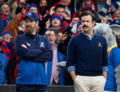 "This image released by Apple TV Plus shows Brendan Hunt, left, and Jason Sudeikis in ""Ted Lasso,"" premiering globally on Friday, August 14. (Apple TV Plus via AP)"