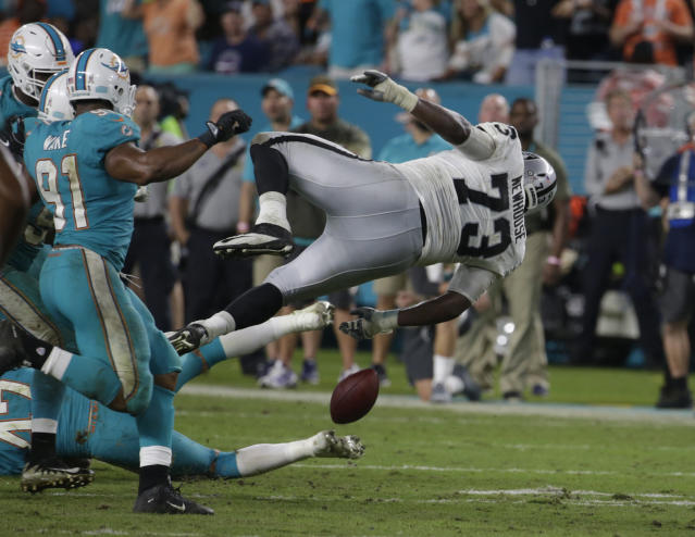 Oakland Raiders offensive tackle Marshall Newhouse went airborne on Sunday night. (AP)
