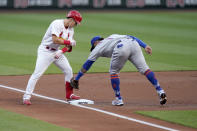St. Louis Cardinals' Tommy Edman, left, arrives at third for a triple ahead of the tag from New York Mets third baseman Jonathan Villar during the first inning of a baseball game Monday, May 3, 2021, in St. Louis. (AP Photo/Jeff Roberson)