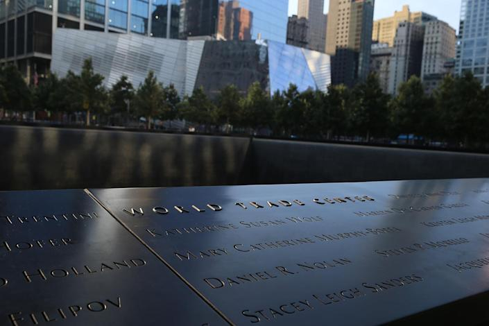 <p>The World Trade Center and names of those who died are inscribed in one of the panels surrounding the South Pool at the National September 11 Memorial & Museum in New York City. (Photo: Gordon Donovan/Yahoo News) </p>