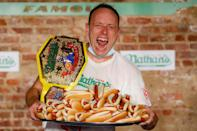 """<p>In 2020, Joey Chestnut broke his own record <em>again</em> <a href=""""https://people.com/food/joey-chestnut-nathans-hot-dog-eating-competition-2019-winner/"""" rel=""""nofollow noopener"""" target=""""_blank"""" data-ylk=""""slk:when he put away 75 hot dogs in 10 minutes (a total of 21.750 calories."""" class=""""link rapid-noclick-resp"""">when he put away 75 hot dogs in 10 minutes (a total of 21.750 calories.</a> Can he top himself this year? </p>"""