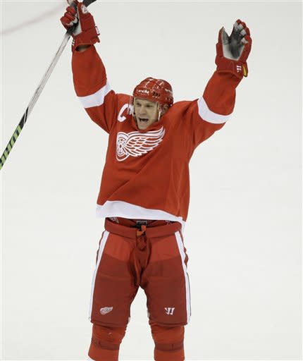 Detroit Red Wings defenseman Nicklas Lidstrom, of Sweden, celebrates scoring the winning goal in overtime against the Calgary Flames in an NHL hockey game in Detroit, Wednesday, Dec. 10, 2008. (AP Photo/Paul Sancya)
