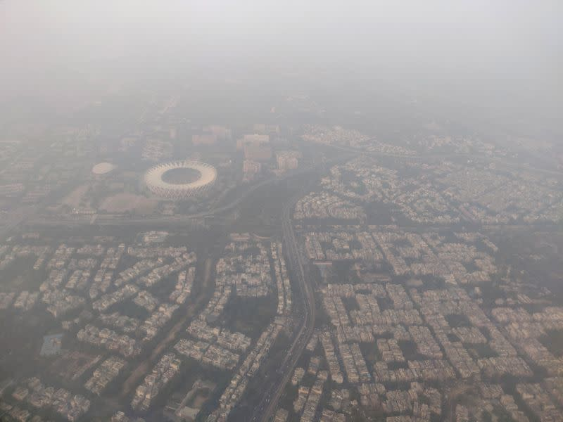FILE PHOTO: FILE PHOTO: An aerial view of the Delhi skyline shrouded in smog, in New Delhi