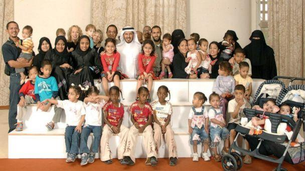 PHOTO: Dr. Abdullah al Rabeeah poses with a multinational grouping of conjoined twins he has operated on in 2010. (Dr. Abdullah al Rabeeah)