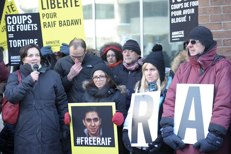 Ensaf Haidar (center), the wife of Saudi blogger Raef Badawi, is shown at a January 2015 vigil for her husband in Montreal, Quebec (AFP Photo/Clement Sabourin)