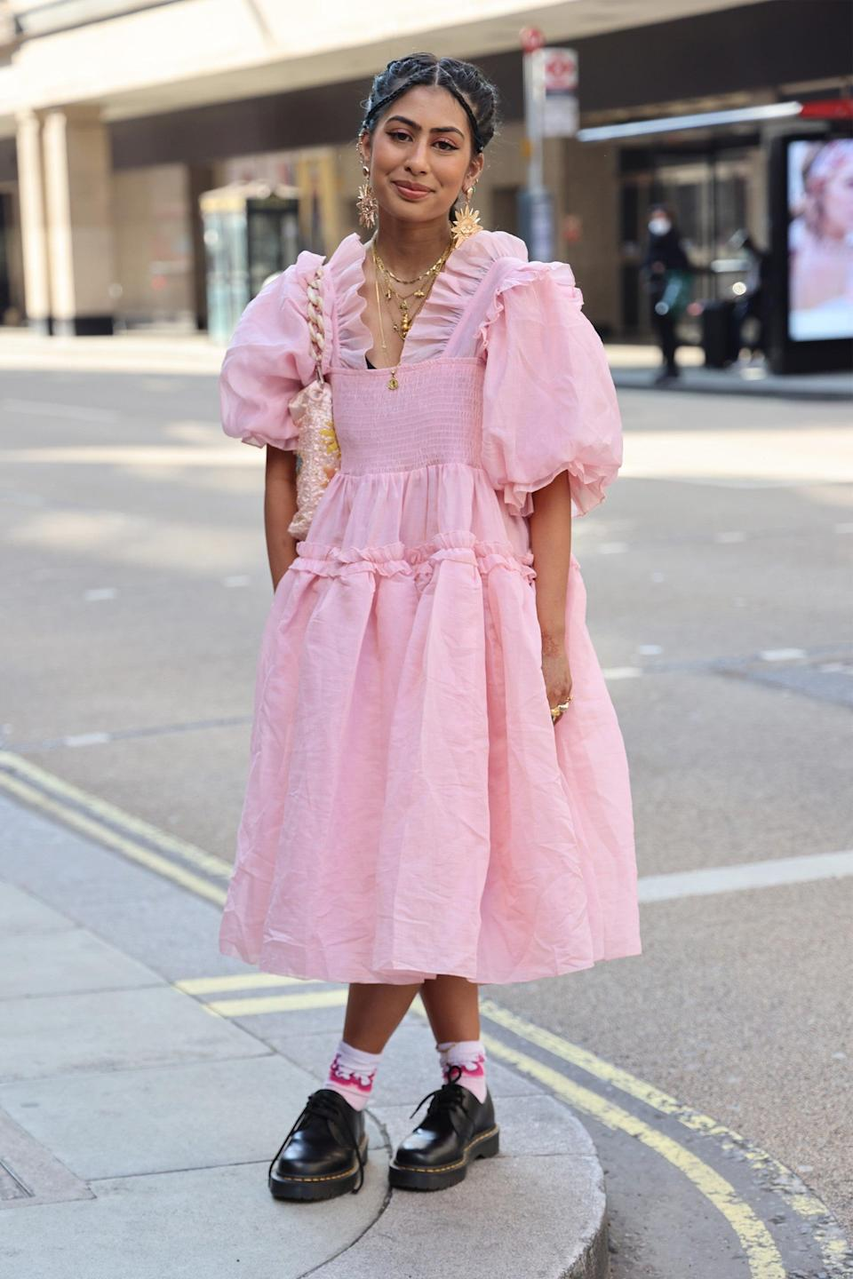 """Pairing a pretty pink dress with classic DMs is a look we will always appreciate.<span class=""""copyright"""">Photo Courtesy of Neil Mockford/Getty Images.</span>"""