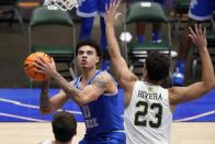 Memphis guard Lester Quinones (11) positions for a shot as Colorado State guard Isaiah Rivera (23) defends in the second half of an NCAA college basketball game in the semifinals of the NIT, Saturday, March 27, 2021, in Frisco, Texas. (AP Photo/Tony Gutierrez)