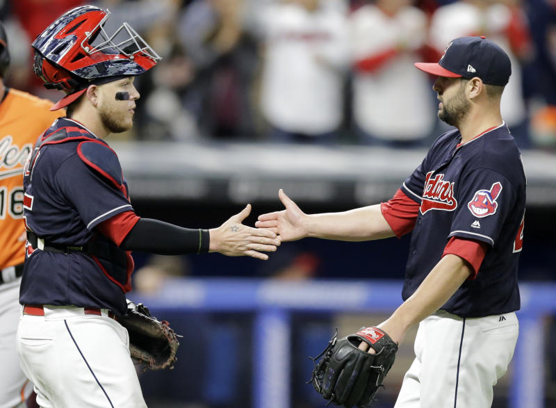 Cleveland Indians relief pitcher Nick Goody, right, is congratulated by catcher Roberto Perez after they defeated the Baltimore Orioles in a baseball game, Friday, Sept. 8, 2017, in Cleveland. (AP Photo/Tony Dejak)