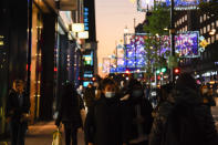 The sun sets on Oxford Street, in London, Wednesday, Nov. 4, 2020. Britain is preparing to join large swathes of Europe in a coronavirus lockdown designed to save its health care system from being overwhelmed. Pubs, along with restaurants, hairdressers and shops selling non-essential items will have to close Thursday until at least Dec. 2. (AP Photo/Alberto Pezzali)