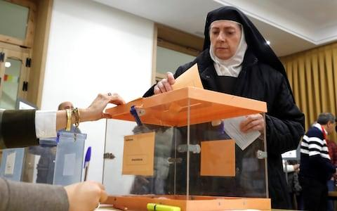 A nun votes at a polling station in Madrid, Spain, 10 November 2019. - Credit: REX