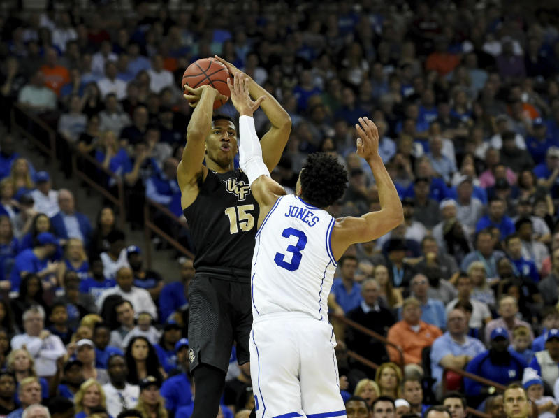 Central Florida's Aubrey Dawkins (15) shoots a three-pointer over Duke's Tre Jones (3) during the first half of a first round men's college basketball game in the NCAA Tournament in Columbia, S.C. Sunday, March 24, 2019. (AP Photo/Richard Shiro)