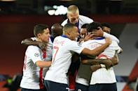 PSG players celebrate beating Manchester United in the Champions League. But they have allowed the chasing pack to close in on them in Ligue 1