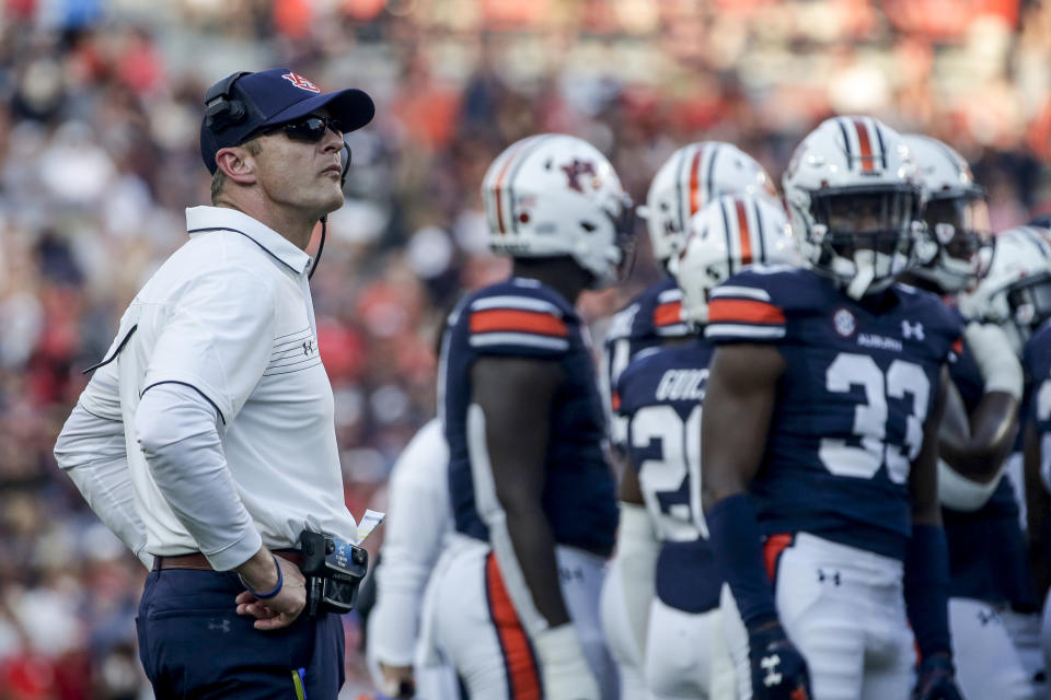 Auburn head coach Bryan Harsin watches a replay during the second half of an NCAA college football game against Georgia, Saturday, Oct. 9, 2021, in Auburn, Ala. (AP Photo/Butch Dill)