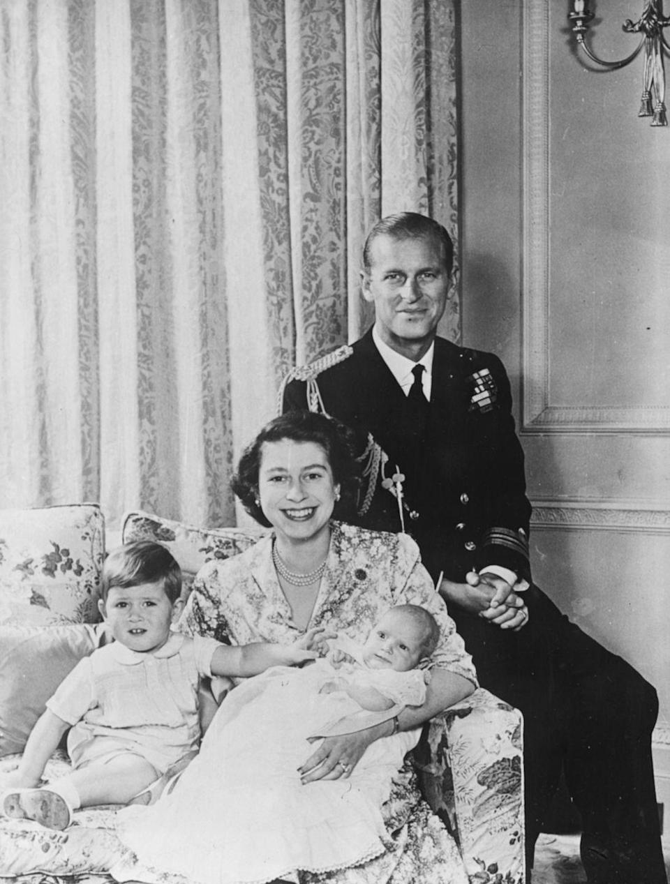 <p>Princess Anne, 2 months, poses for a photo with her brother, Prince Charles, 23 months, and their parents, Princess Elizabeth and Prince Philip, at Buckingham Palace. Elizabeth would become queen just two years later.</p>