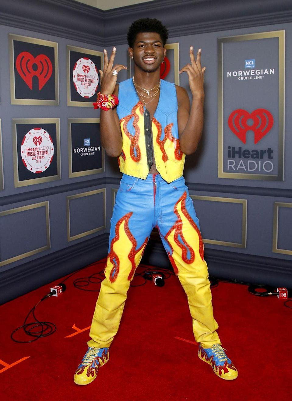 <p>It's prob too on the nose the say this look was fire, but it's the truth! Something about this artist's commitment to matching sets always works. Example number 856? This outfit at the iHeart Radio Music Festival, from the vest to the kicks.</p>