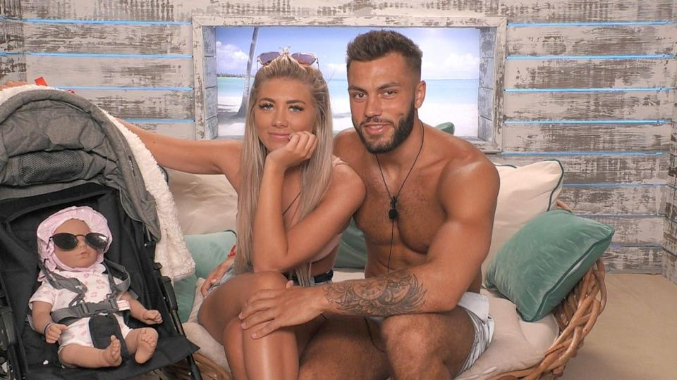 Winter Love Island 2020 winners Paige Turley and Finn Tapp play at being parents on the show. (ITV)