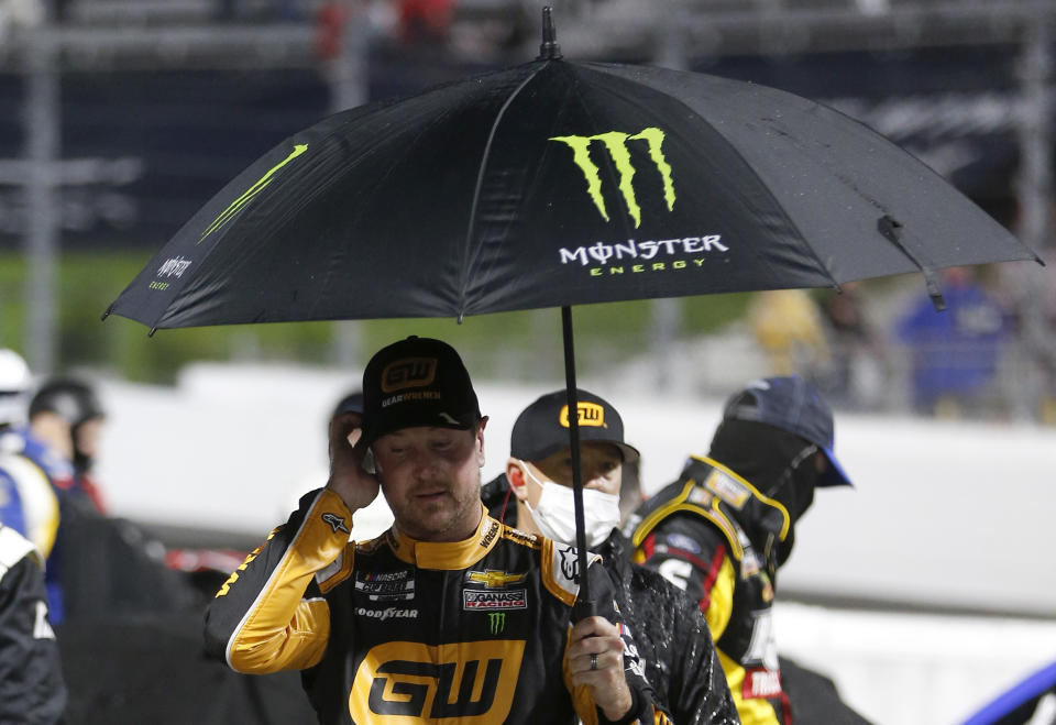 MARTINSVILLE, VIRGINIA - APRIL 10: Kurt Busch, driver of the #1 GEARWRENCH Chevrolet, walks the grid during a rain delay during a rain delay prior to the NASCAR Cup Series Blue-Emu Maximum Pain Relief 500 at Martinsville Speedway on April 10, 2021 in Martinsville, Virginia. (Photo by Brian Lawdermilk/Getty Images)